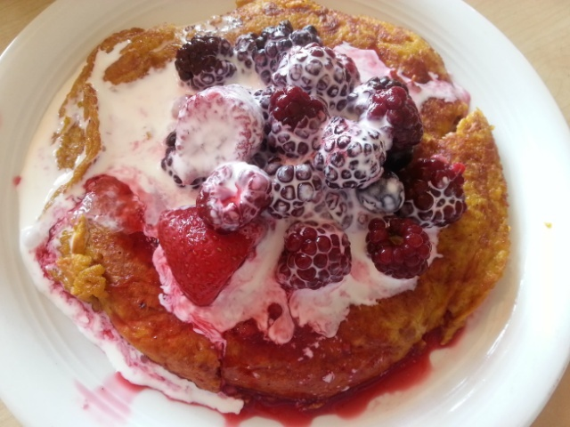 Sweet potato pancake smothered with berries and cream